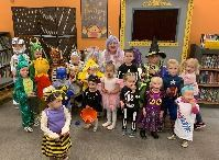 Children dressed in Halloween costumes at the Library