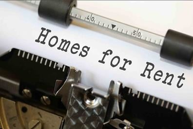 Paper in typewriter with the text Homes for Rent