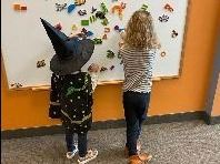 Kids at white board